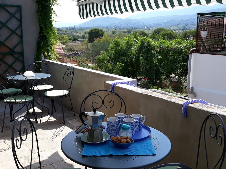 Enjoy your coffee with a view of UNESCO-protected Stari Grad Plain and distant hills.