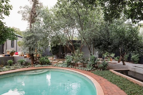Chill Among the Lush Foliage at a Tranquil Poolside Oasis