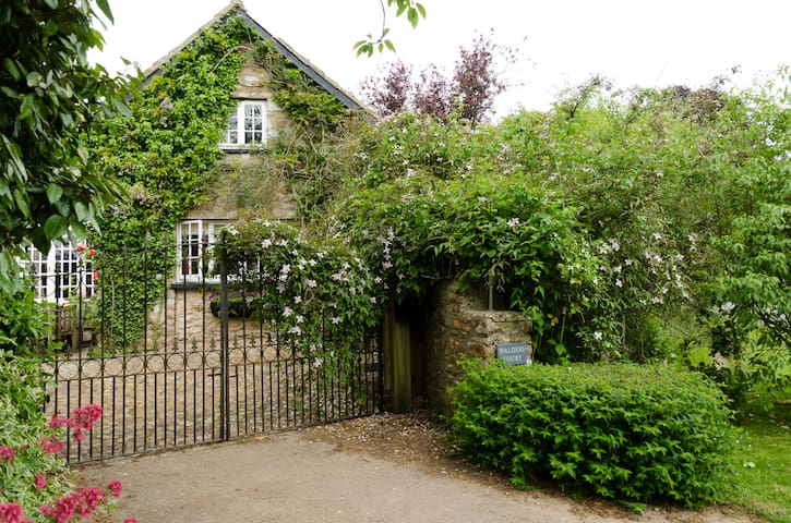 Arriving at Walders Court - come through the wrought iron gates, turn right and into the Cottage garden.