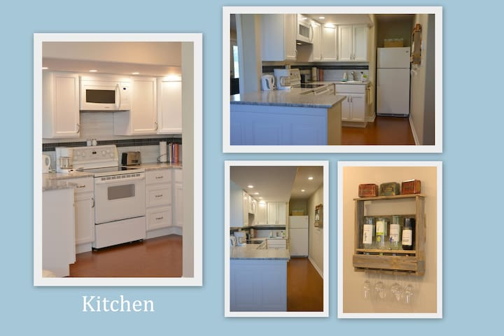 Kitchen area with lots of items to use during your stay. Full sized fridge, stove and microwave.
