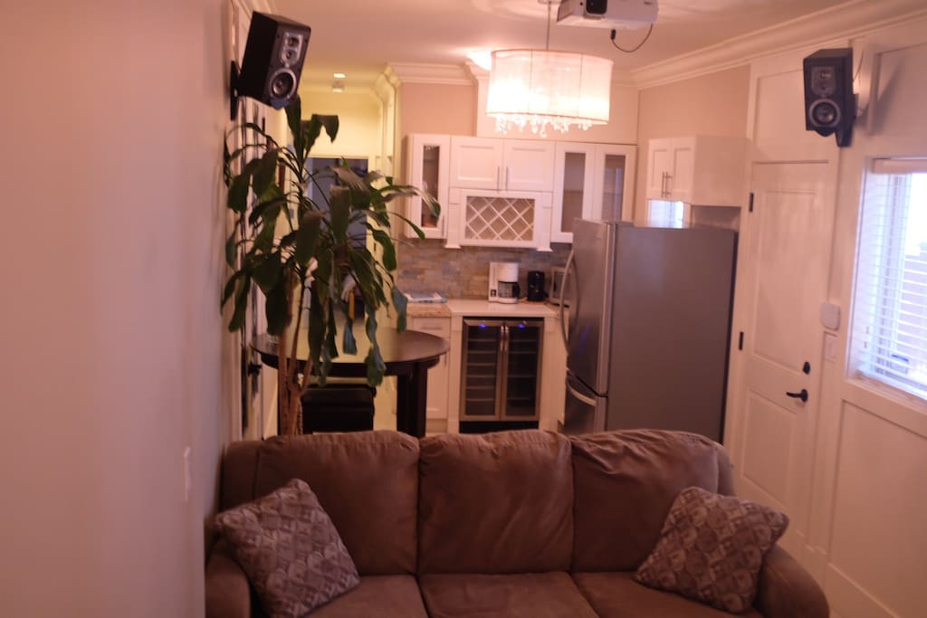 Comfortable sectional sofa, small eating area, & kitchen.