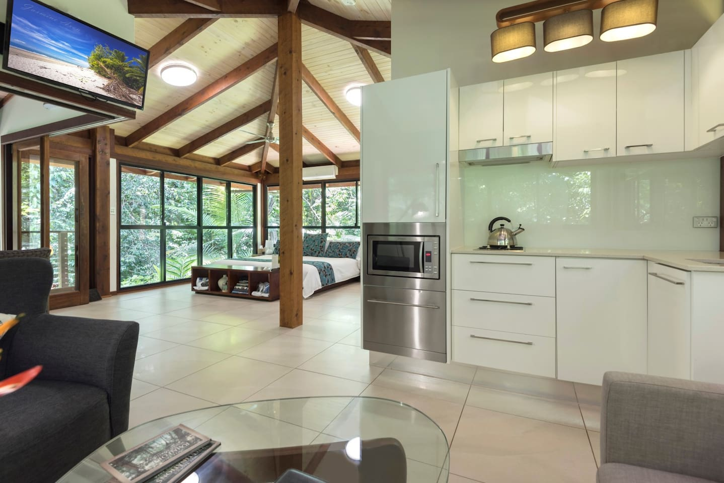 Floor to ceiling glass walls for stunning views of your own private piece of Daintree Rainforest...enormous super king bed,double spa bath, double rainshower with glass wall...luxuriate in air conditioned comfort of the Black Palm spa cabin