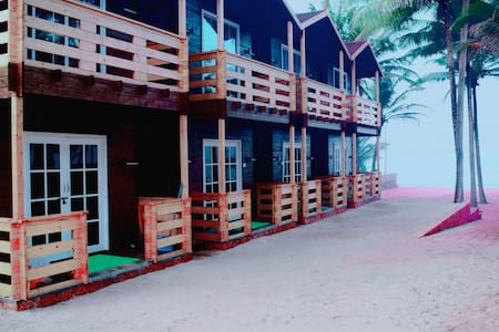 Arabian sand sea view wooden Villa