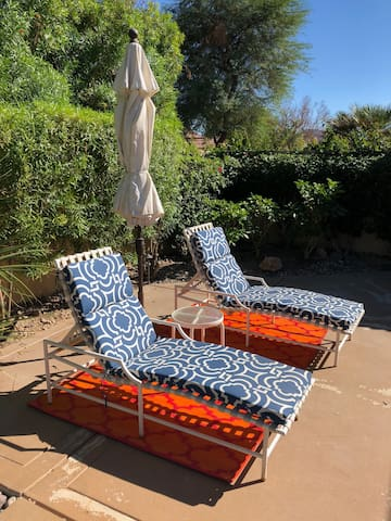 Sunny lounge chairs (east patio)