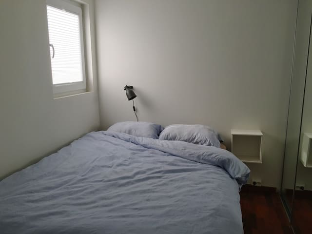 Master bedroom. Choose between a double or two single duvets. There is plenty of closet space on the right hand side of the bed.