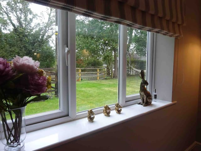 The ground floor room has lovely views across the open countryside and garden