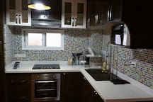 Very classy and modern kitchen with branded Italian appliances and amenities.