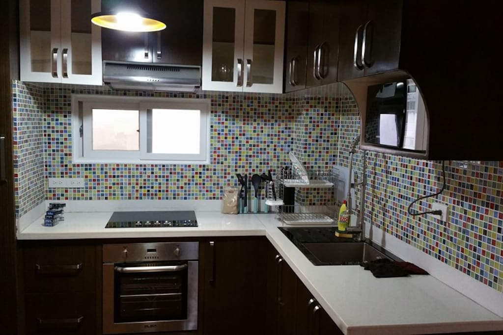 Very classy and modern kitchen with Italian appliances and amenities.