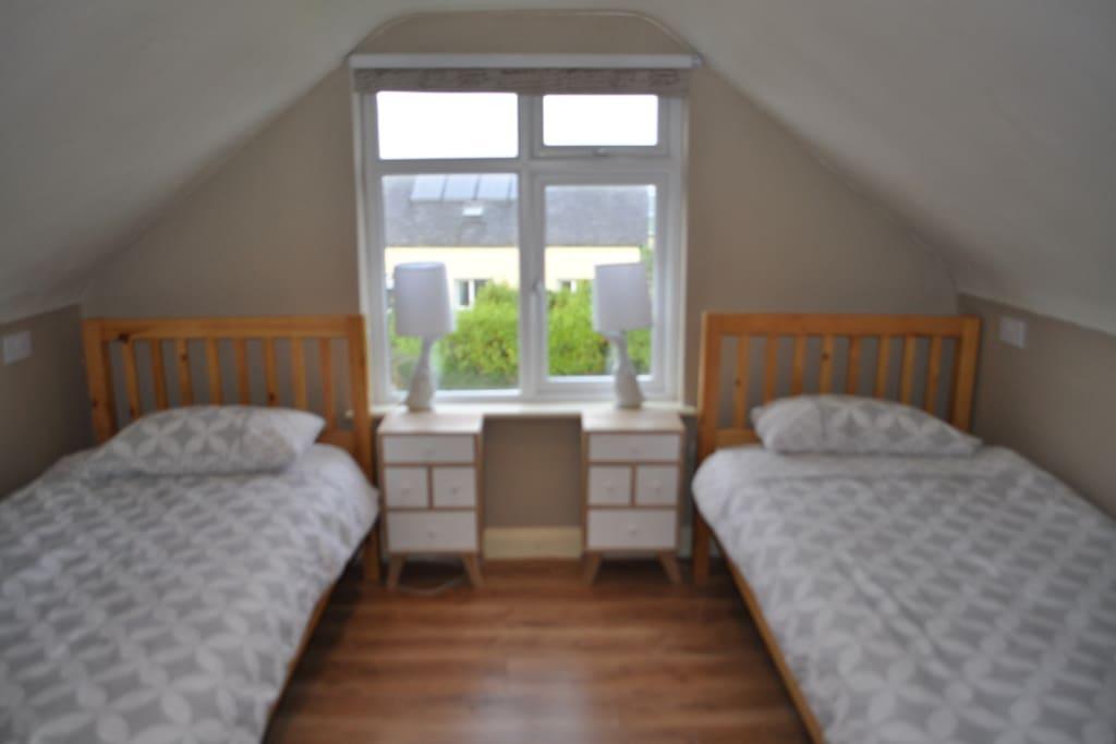 Twin Bedroom - Partial sea view