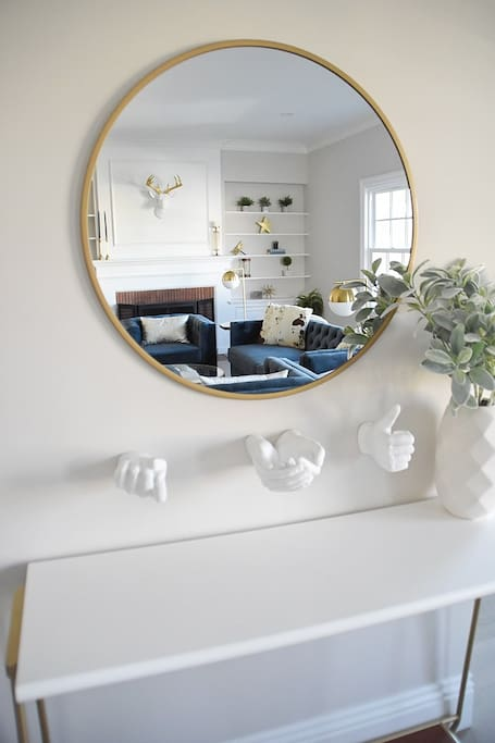 console table and mirror at entry
