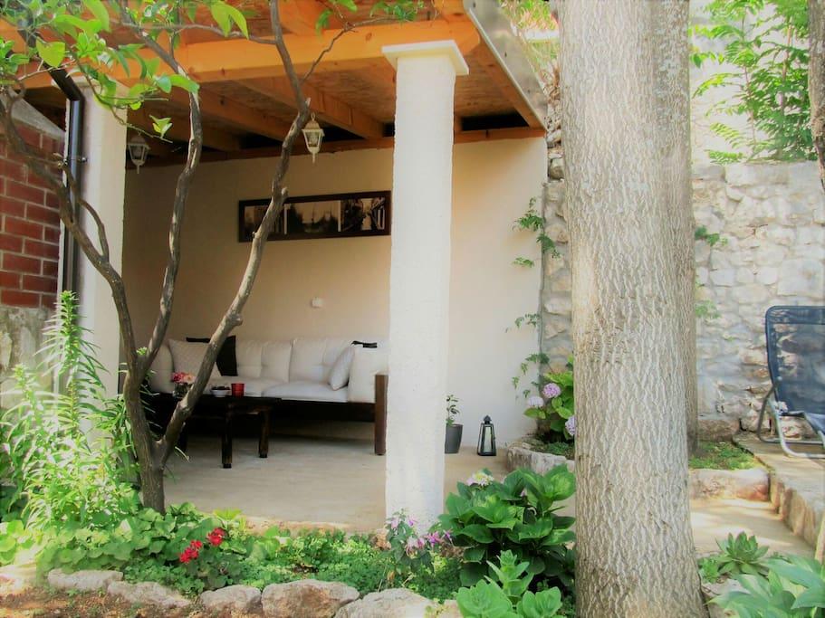 Enjoy hot summer days under perfect shade overlooking the Mediterranean garden