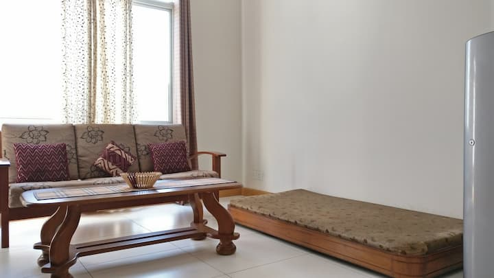 Cosy 1BHK home next to Expo Mart & Golf Course