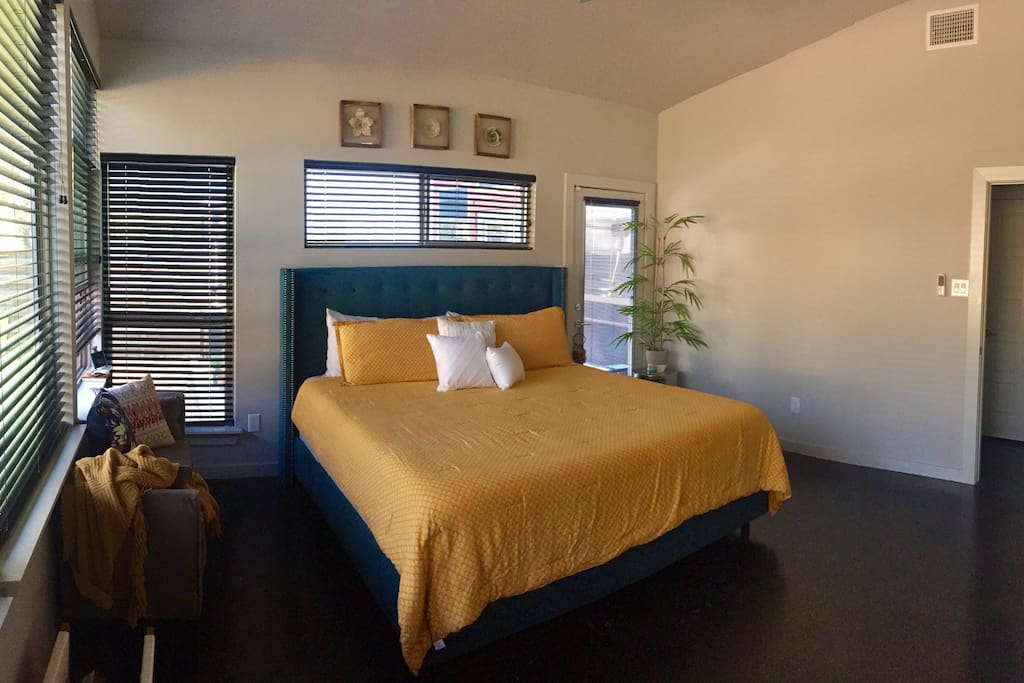 The master bedroom is a retreat paradise. Located at the back of the house, it has its on private entry. With multiple windows, it brings in the morning sunlight. The cozy king bed puts the icing on the cake.