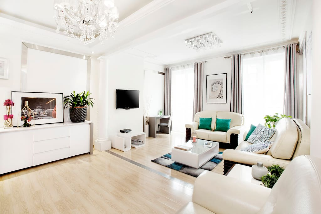 Spacious First Living room with a desk and a TV with over 100 channels