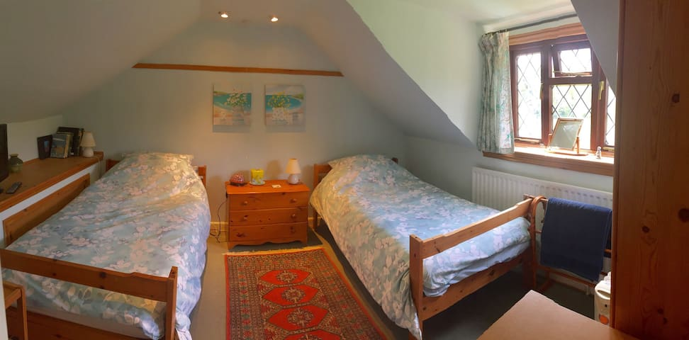 Quiet twin room with rural views.
