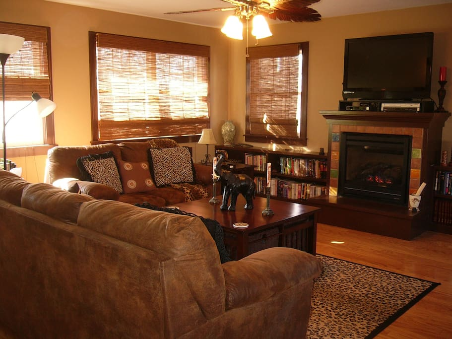 Sunroom with fireplace, tv/dvd, snacks, water, coffeepot, and small refrigerator (shared space)