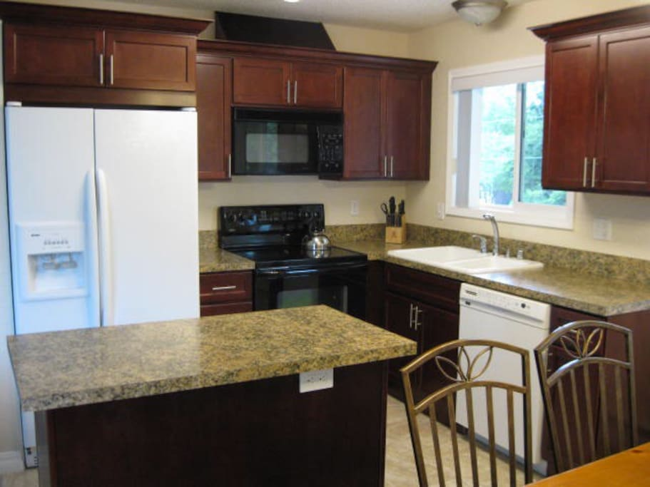 Nicely remodeled kitchen with Cherry cabinets... all cookware and dishware included.
