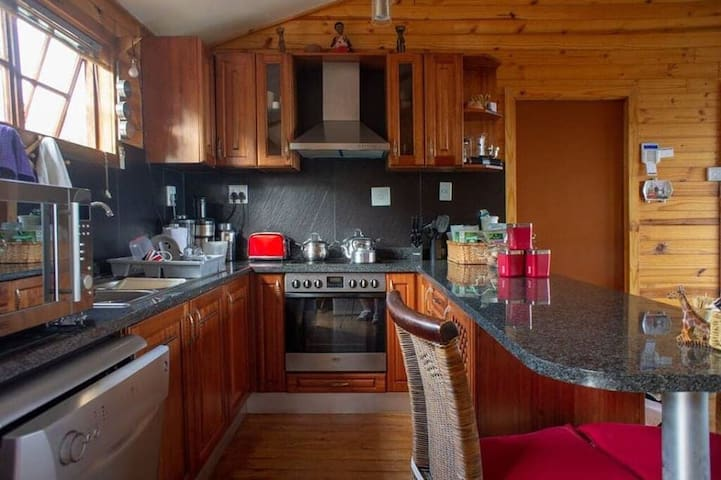 self catering kitchen with fridge, deep freezer, dishwasher, juicer, blender, coffee bean grinder, traditional coffee maker, kettle, toaster, microwave, hob, themorfan oven, pts dishes etc