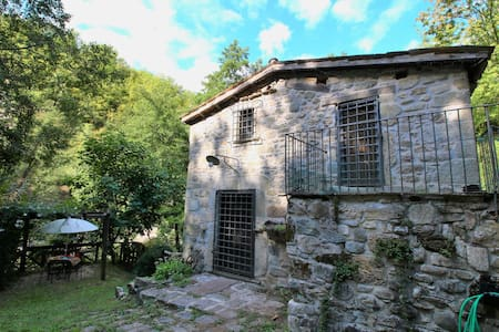 Holiday home in a water mill, next to a waterfall and natural swimming pond