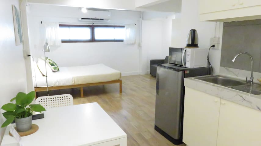 Dining area, kitchenette (no cooking, just a microwave), refrigerator, electric kettle & queen size bed.