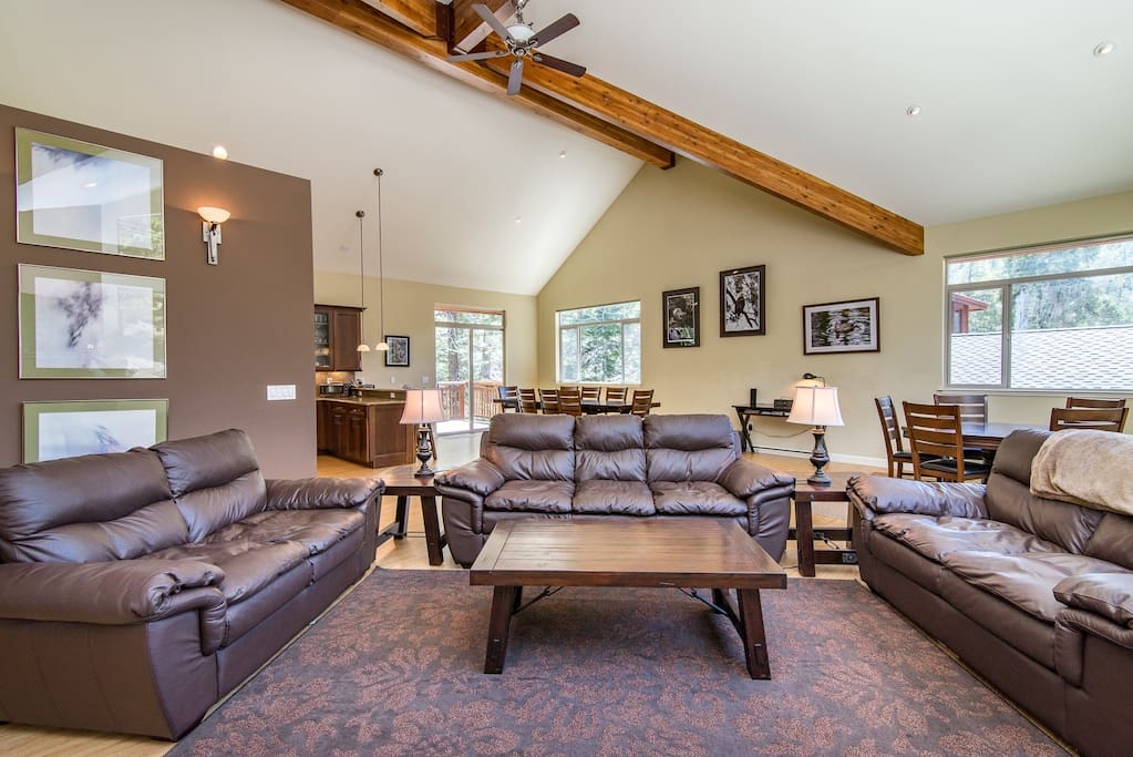 Leather sofas offer seating for 7 in the living area.