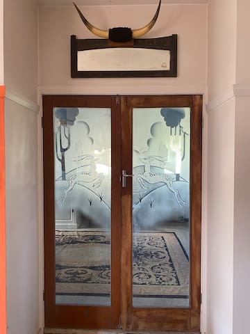 """These Art-deco doors lead into the """"blue bedroom""""."""