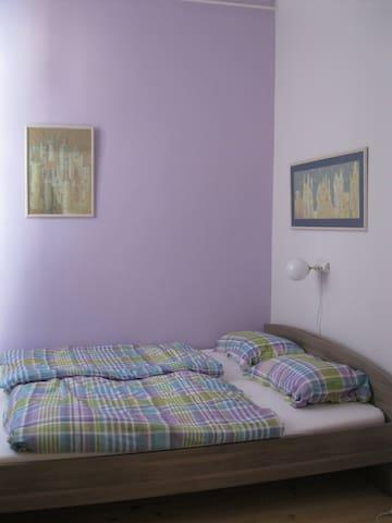 Purple room with queen bed