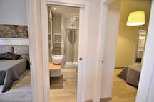 On the Left One Bedroom. The main Bathroom in the middle and other Bedroom on the right with en-Suite Bathroom!