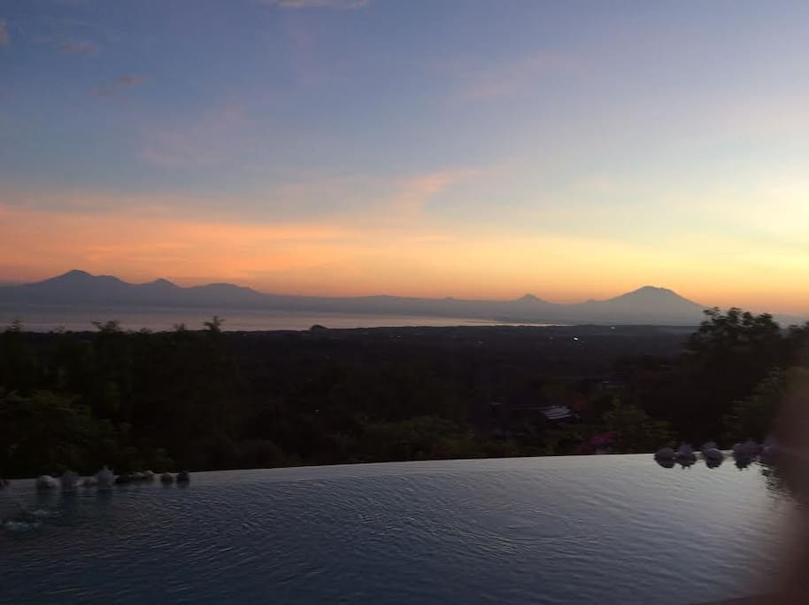 overlooking the sunrise and Agung Volcano from the pool