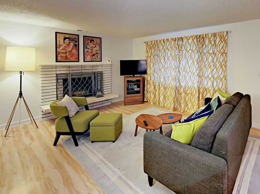 Spacious living room with flat screen TV. Complimentary Wi-Fi also provided.