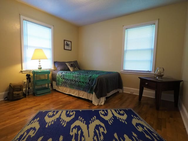 This is the guest bedroom. It is suitable for 2 maybe three people if they are okay with an air mattress. It has several outlets and some surfaces to put belongings.