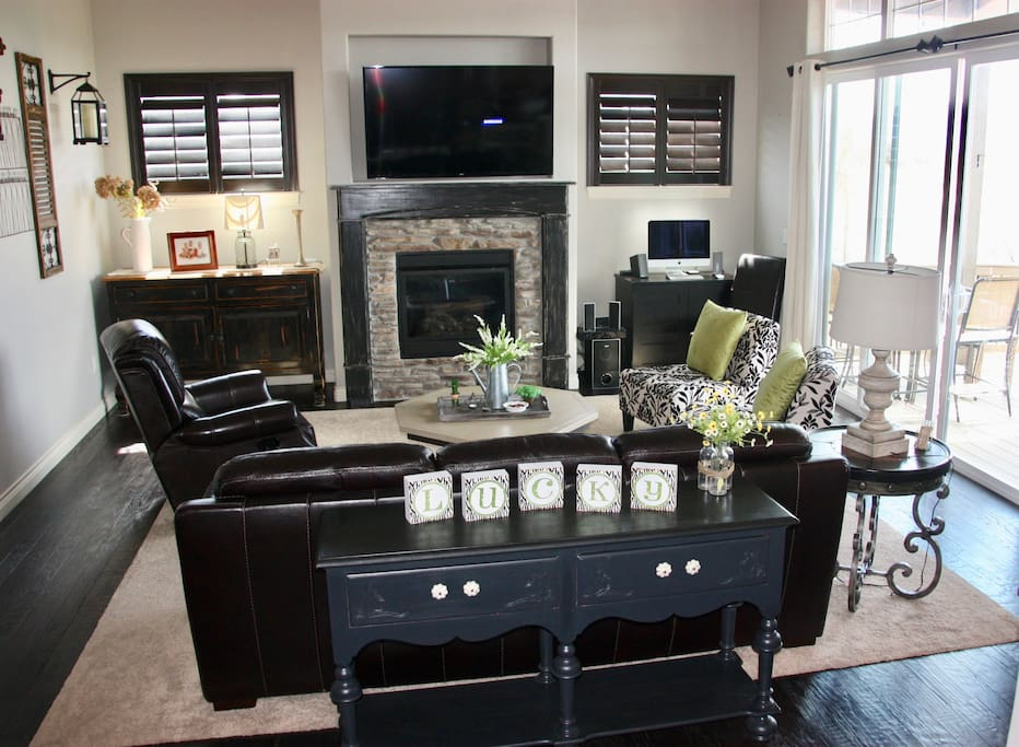 Upstairs Living Room with gas fireplace; oversized patio doors lead to upper deck