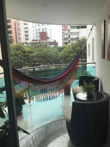 Private balcony with hammock overlooking the park