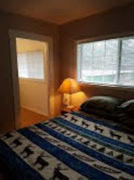 Bedroom with queen size memory foam bed + bathroom & shower
