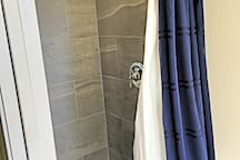 Tiled shower in the master bathroom