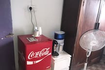 Wardrobe space available in room. Storage space with fan, water dispenser, kettle with complimentary tea and coffee.