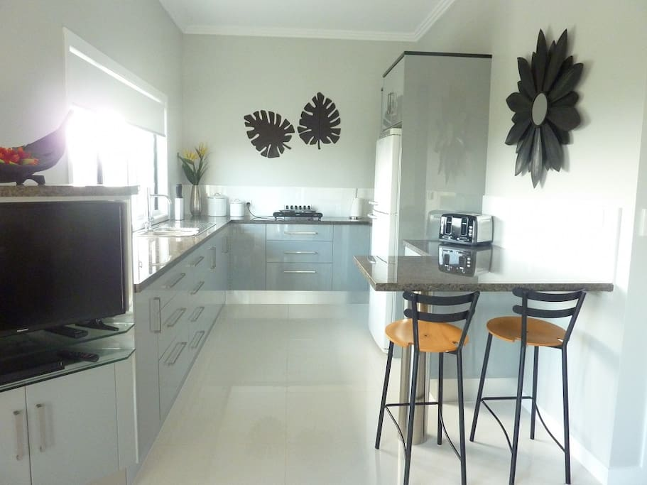 Kitchen with magnificent view over water feature and to Mt. Warning