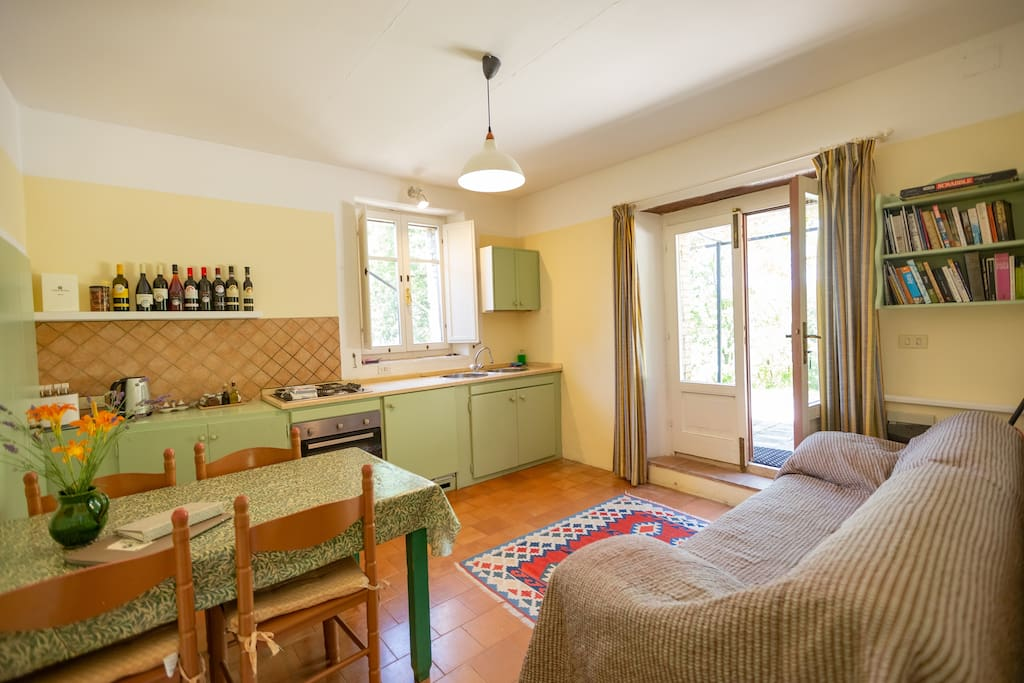 Living room with sofa, dining table and four chairs, china cupboard, Wi-Fi access. Kitchen area with fitted cupboards and marble work surface, inset gas hob, sink, built-in fridge/freezer, oven with grill, microwave, iron and ironing board.