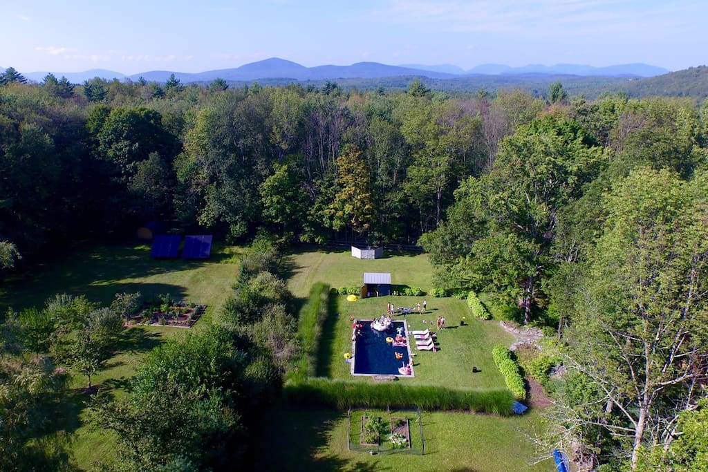 Aerial view of grounds and pool with Catskill mountains in background