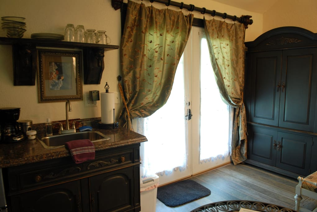 The large armoire is for hanging your clothes or putting clothes into so you don't have to live out of a suitcase....