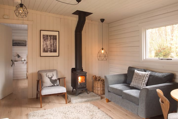 Log cabin set in wooded secluded private grounds