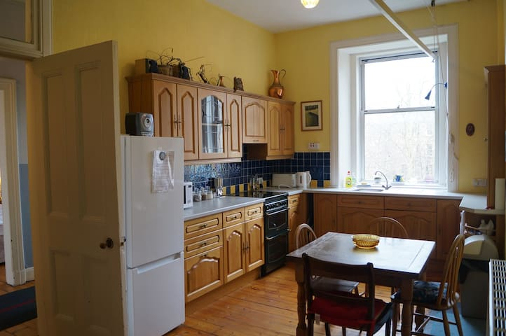 The large dining kitchen faces the rear of the property.  As well as the usual cooker, fridge and freezer a washing machine and tumble dryer are housed in a pantry just off the kitchen