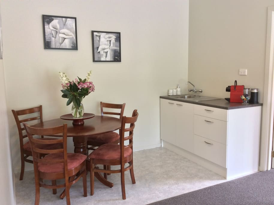 Kitchenette with Nespresso machine & dining table