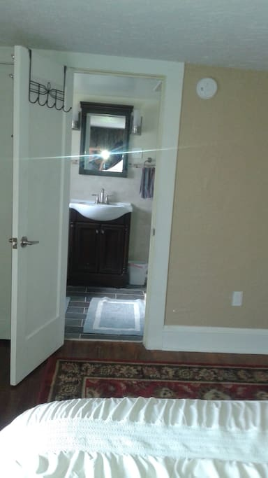 view to private bath towels and amenities provided