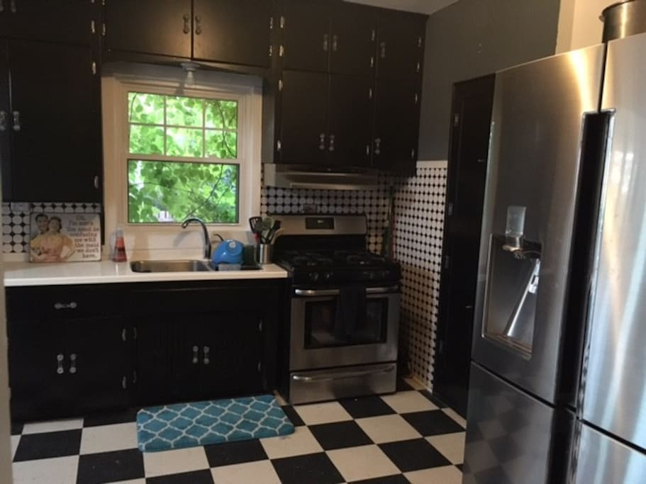 Full kitchen, lots of dinnerware, and equipped with a gas stove.