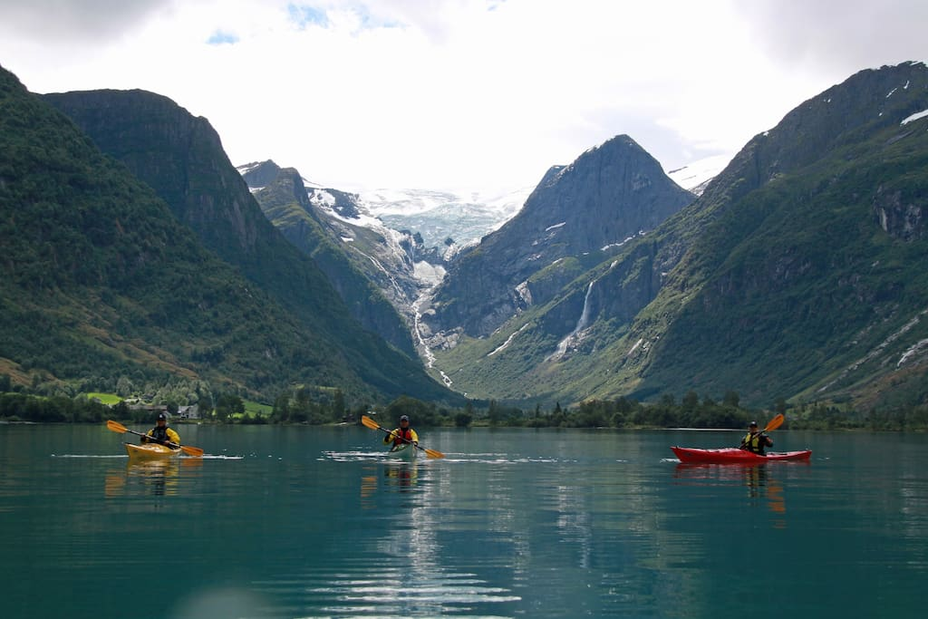 Kayak padeling at the Oldevatn lake with view to Melkevoll glacier.