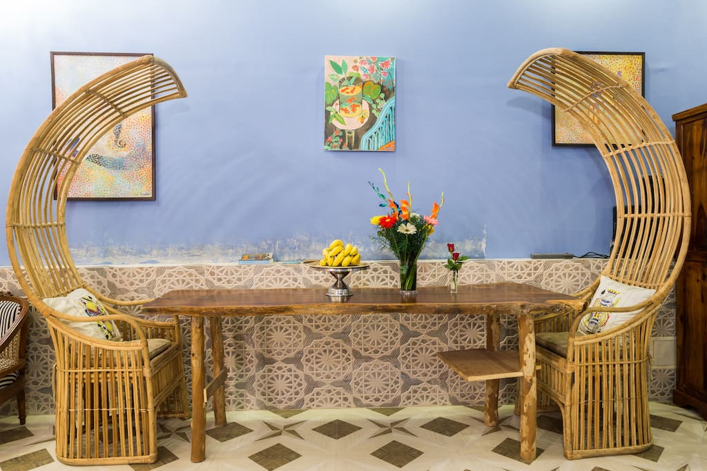 Bespoke dining table with handmade cane chairs