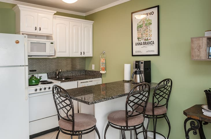 Eat in tonight...fully stocked kitchen with oven, cooktop, microwave, dishwasher and full size refrigerator