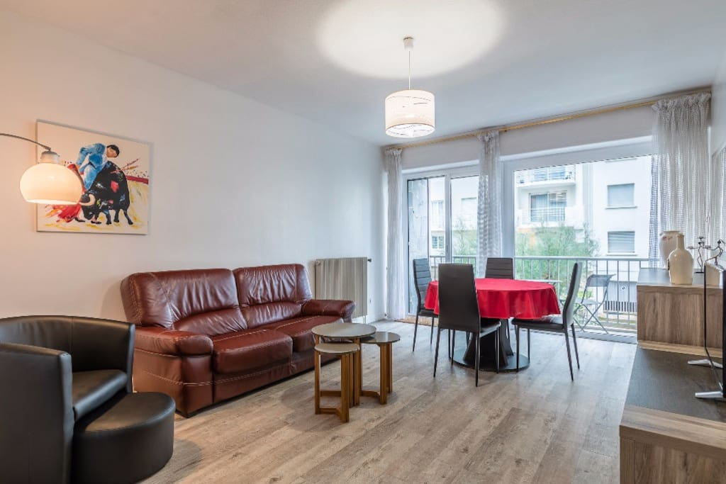 Bright living-room with dining table