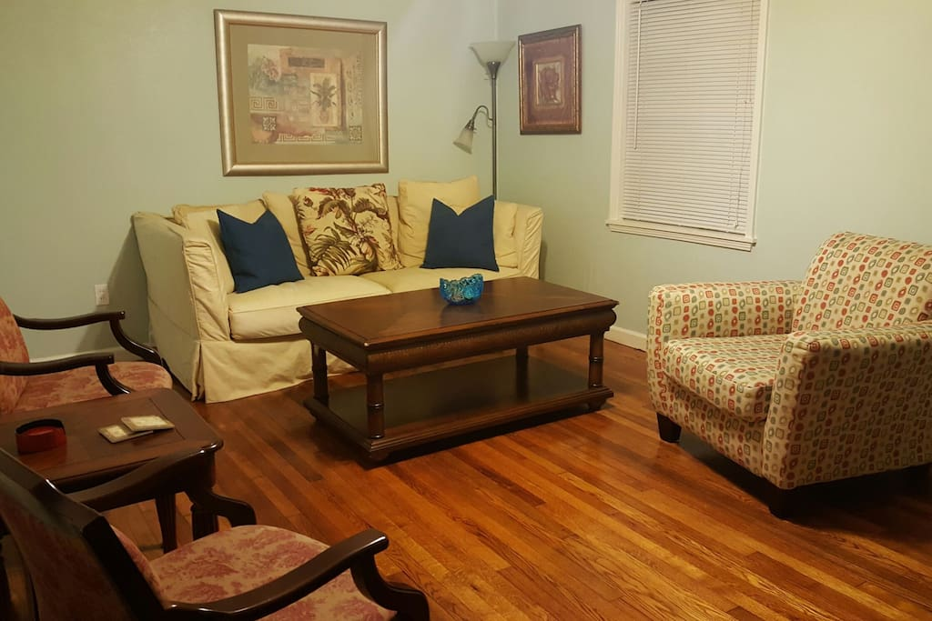 Livingroom with beautiful original hard wood floors.